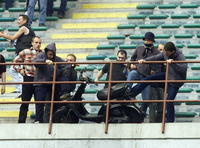 translation not available – VIOLENCE. Milano (Italy), May 6th 2001. Inter - Atalanta. Hooligans smuggle a scooter into San Siro stadium, burn it and throw it  from the strands