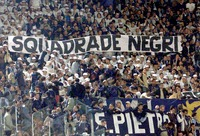 "RACISM. Olympic Stadium Rome 29 April 2001. Ultras from Lazio's 'Curva Nord' show racist banners against its lifetime rival, Roma. ""Team of niggers"""